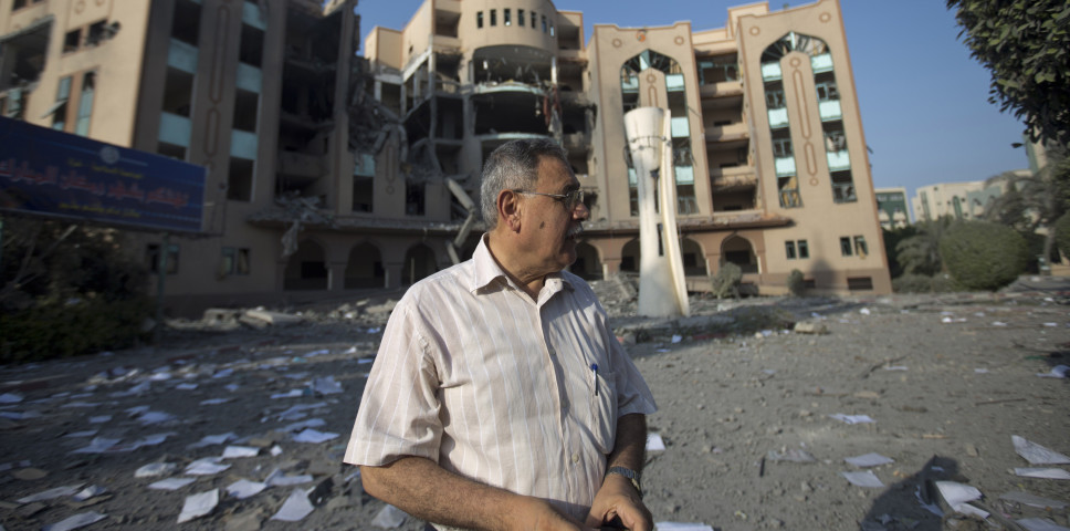 The director of the Islamic University of Gaza inspects the damage to the institution.